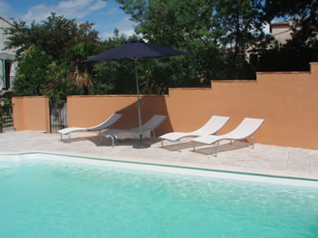 Sun Loungers by Pool